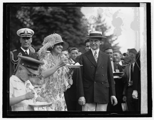 President and Mrs. Coolidge enjoying a June, 1926 garden party.